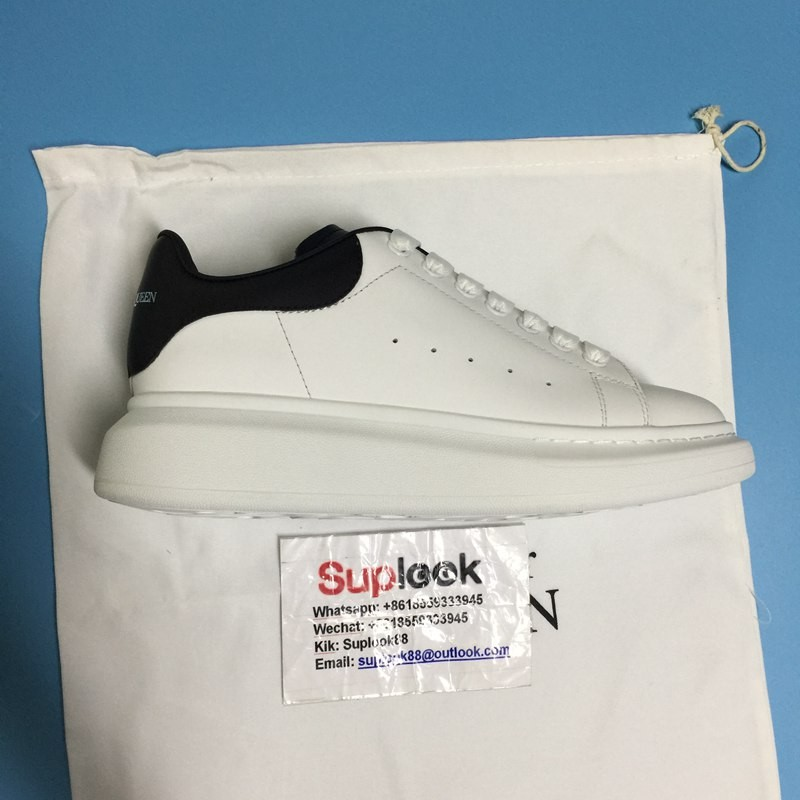A-lexand-er M-cQuee-n white black tail sneakers