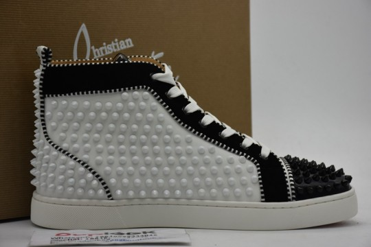 C-hristian L-ouboutin sneakers are studded in black and white